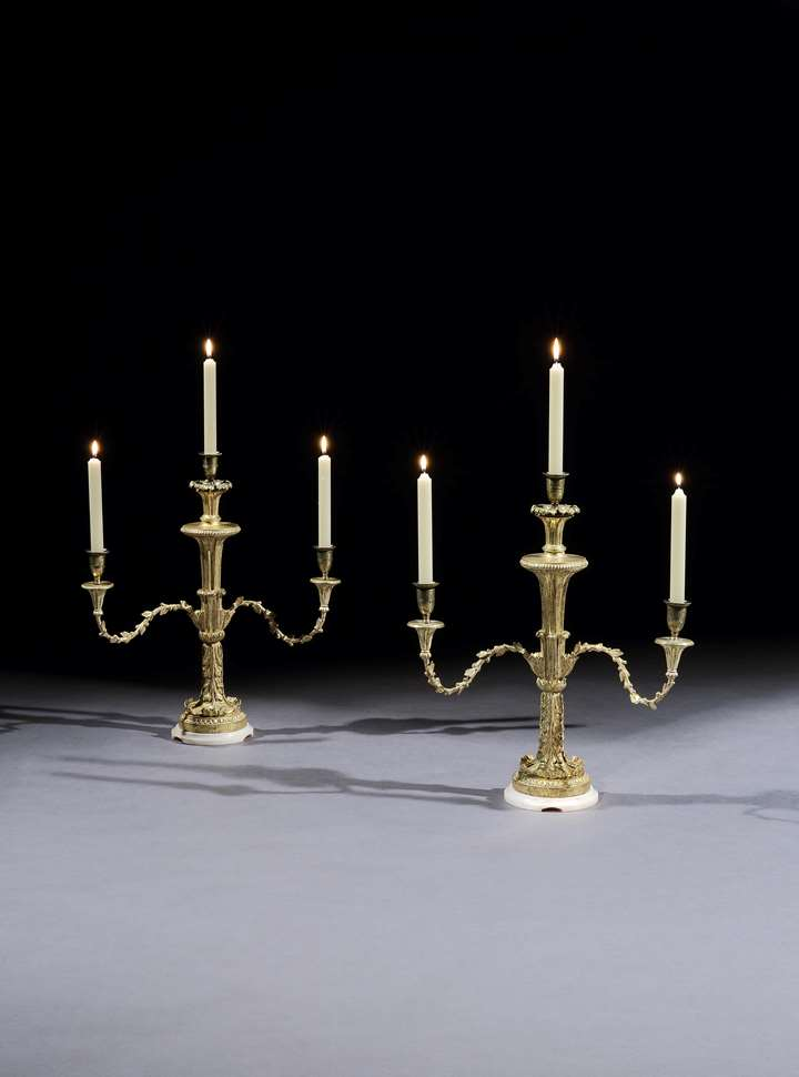 A PAIR OF GEORGE III GILTWOOD CANDELABRA ATTRIBUTED TO THOMAS CHIPPENDALE