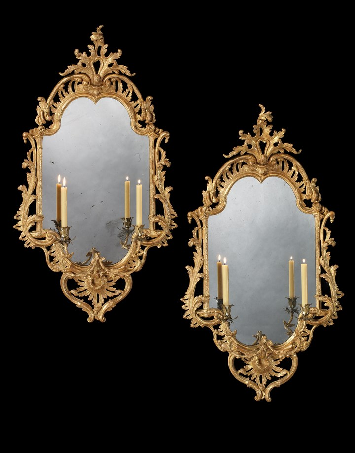 A PAIR OF GEORGE III GILTWOOD TWO LIGHT GIRANDOLES