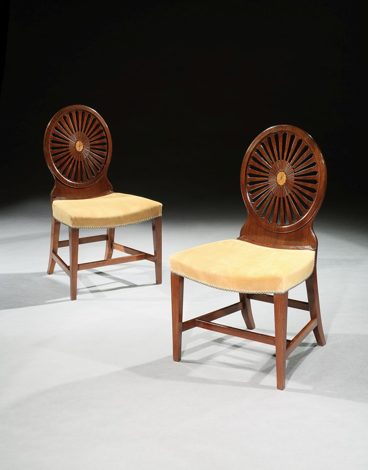 A PAIR OF GEORGE III MAHOGANY WHEEL BACK SIDE CHAIRS