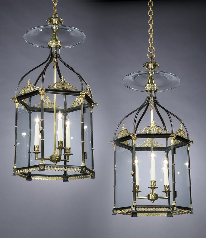 A PAIR OF GEORGE III ORMOLU AND BRONZE HALL LANTERNS