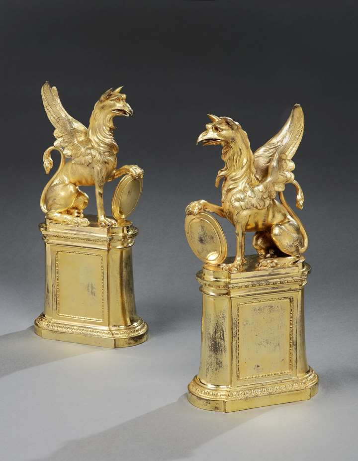 A PAIR OF GEORGE III ORMOLU GRIFFIN CHENETS