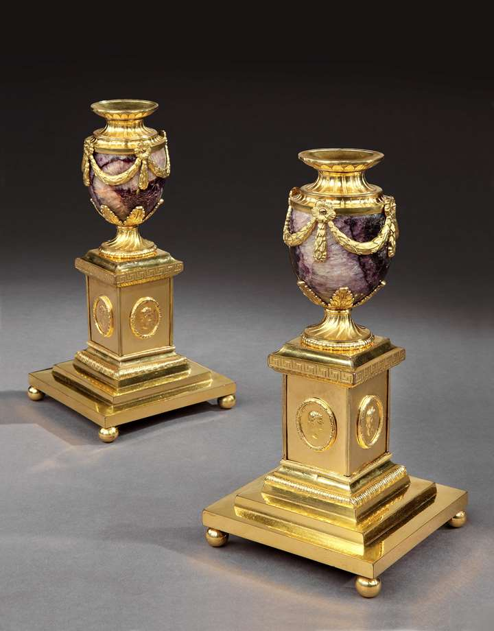 A PAIR OF GEORGE III ORMOLU MOUNTED 'NEW CAVERN VEIN' BLUE JOHN CLEOPATRA CANDLE VASES