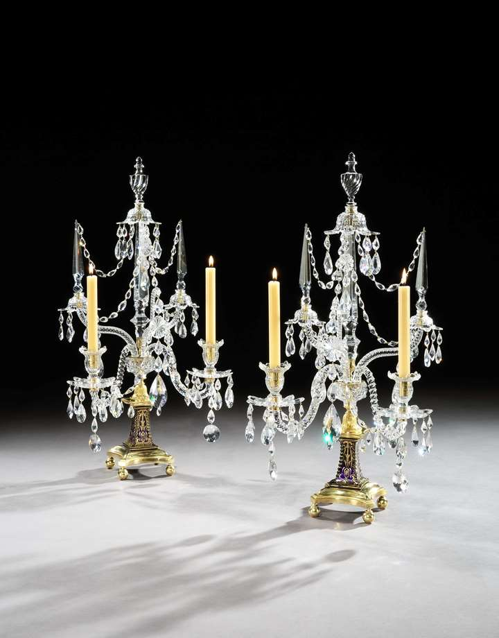 A PAIR OF GEORGE III ORMOLU MOUNTED CUT GLASS TWO LIGHT CANDELABRA BY WILLIAM PARKER & SON