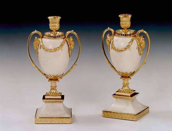 A pair of George III white marble candle vases