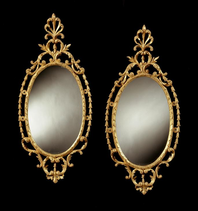 A PAIR OF GEORGE III OVAL GILTWOOD MIRRORS | MasterArt