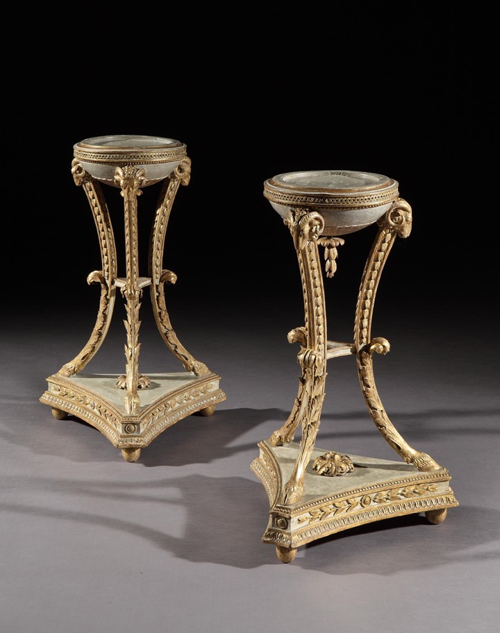 A PAIR OF GEORGE III PARCEL GILT TORCHERES