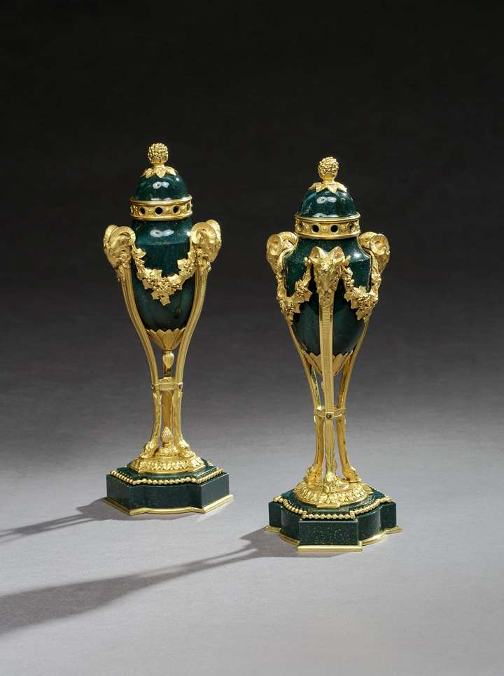A PAIR OF ORMOLU MOUNTED BLOOD-STONE POT-POURRI VASES