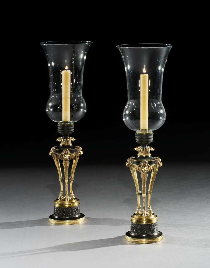 A PAIR OF REGENCY BRONZE AND ORMOLU STORM LIGHTS