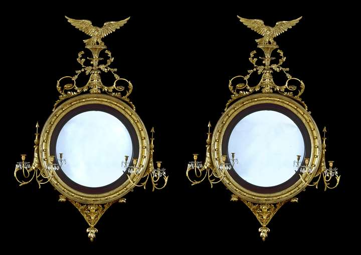 A PAIR OF REGENCY CONVEX MIRRORS