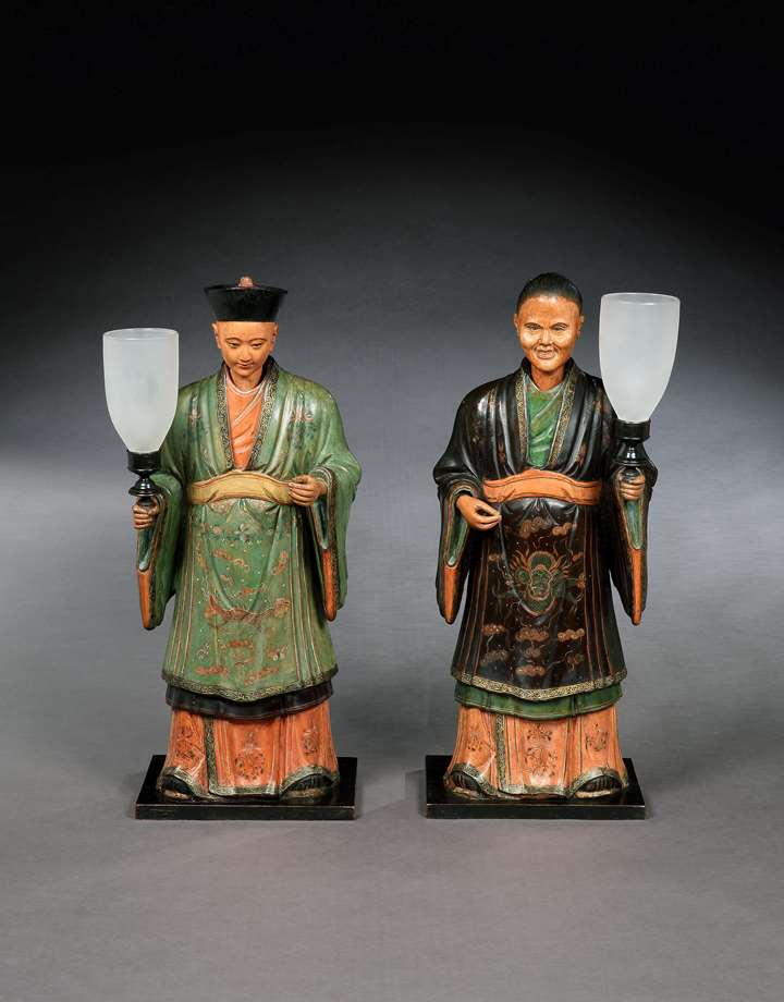 A PAIR OF REGENCY POLYCHROME DECORATED FIGURES OF A MANDARIN AND HIS CONSORT MOUNTED WITH LAMPS
