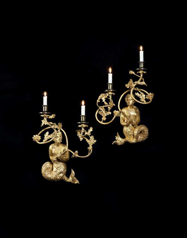 A PAIR OF REGENCY GILTWOOD TWIN LIGHT MERMAID WALL LIGHTS