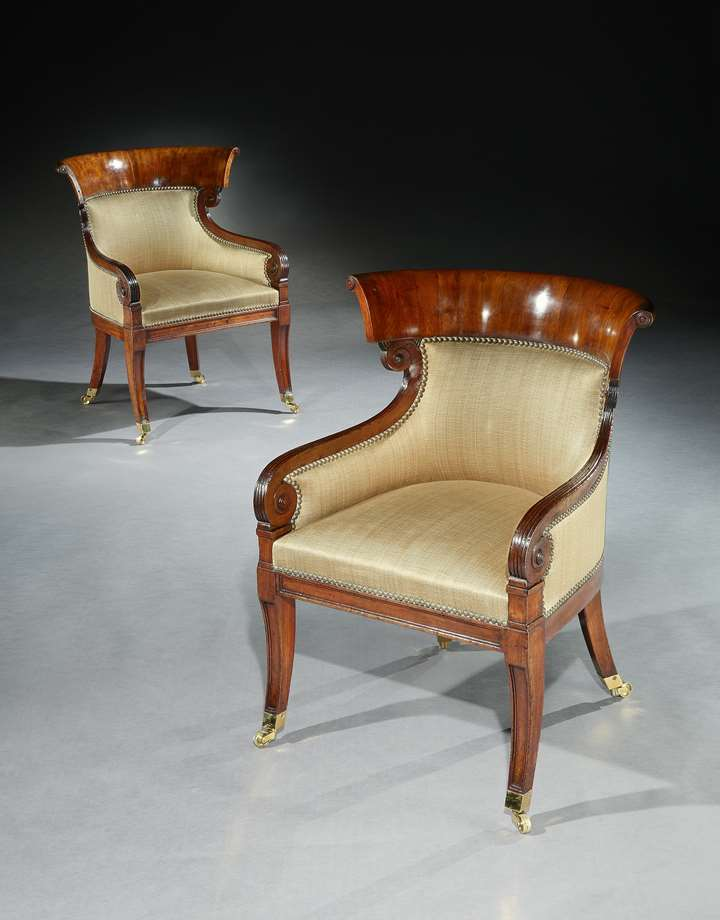 A PAIR OF REGENCY MAHOGANY KLISMOS BERGÈRE CHAIRS