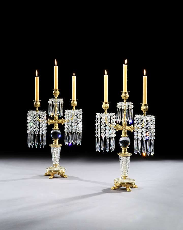 A PAIR OF REGENCY ORMOLU MOUNTED CUT GLASS CANDELABRA