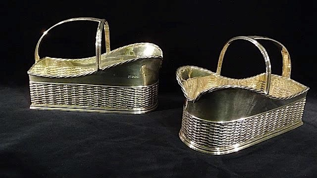 A PAIR OF STERLING SILVER BOTTLE HOLDERS BY THOMAS BRADBURY