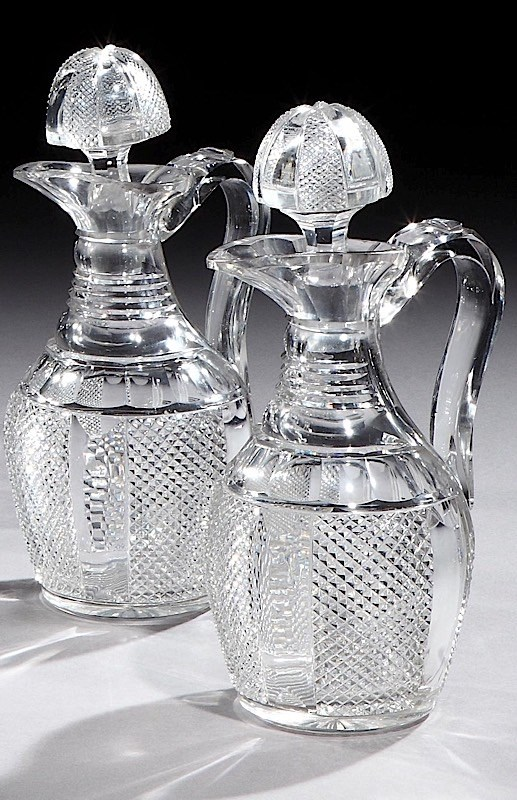 A PAIR OF VICTORIAN SILVER MOUNTED CUT GLASS CLARET JUGS