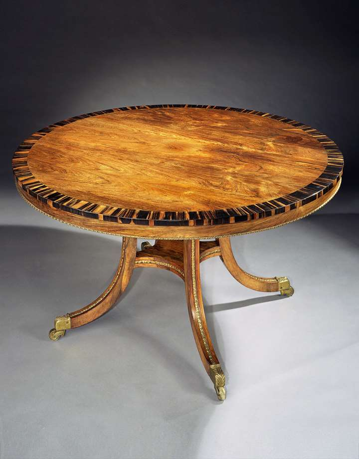 A REGENCY BRASS MOUNTED ROSEWOOD CENTRE TABLE ATTRIBUTED TO GILLOWS