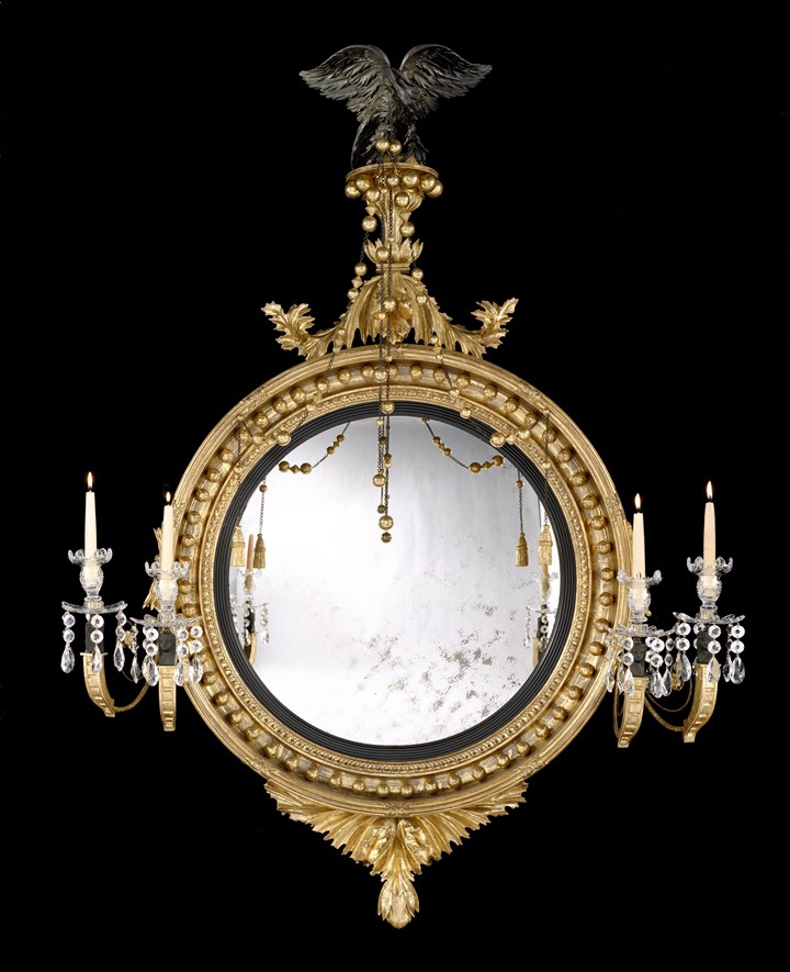 A REGENCY GILTWOOD CONVEX MIRROR ATTRIBUTED TO THOMAS FENTHAM
