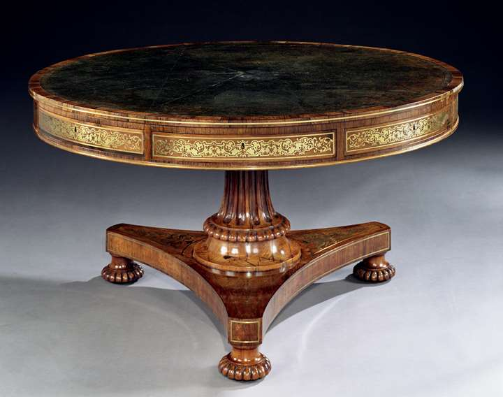 A REGENCY ROSEWOOD DRUM TABLE