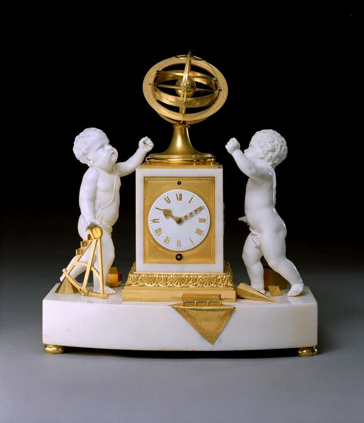 A REGENCY WHITE MARBLE PORCELAIN AND ORMOLU CLOCK