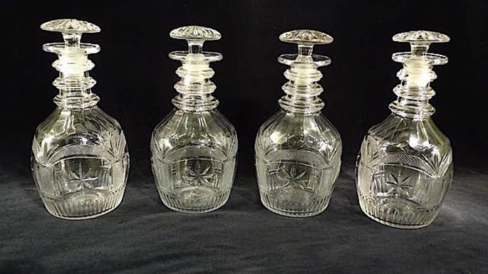 A SET OF FOUR REGENCY CUT GLASS DECANTERS | MasterArt