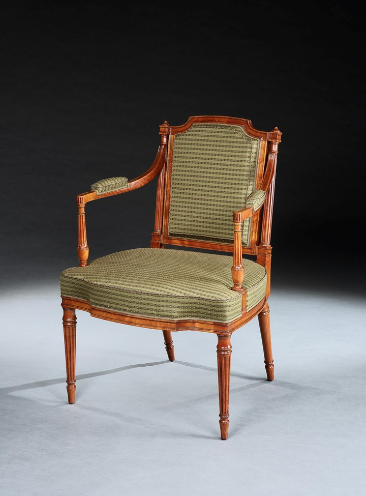A SET OF SIX GEORGE III SATINWOOD OPEN ARMCHAIRS