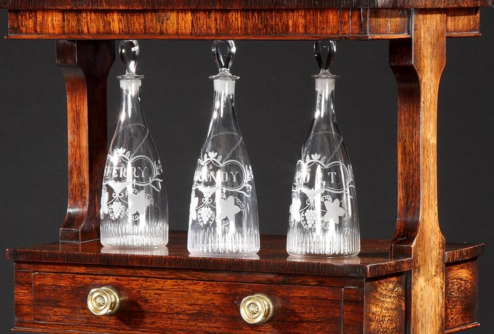A SET OF THREE GEORGE III ENGRAVED GLASS DECANTERS