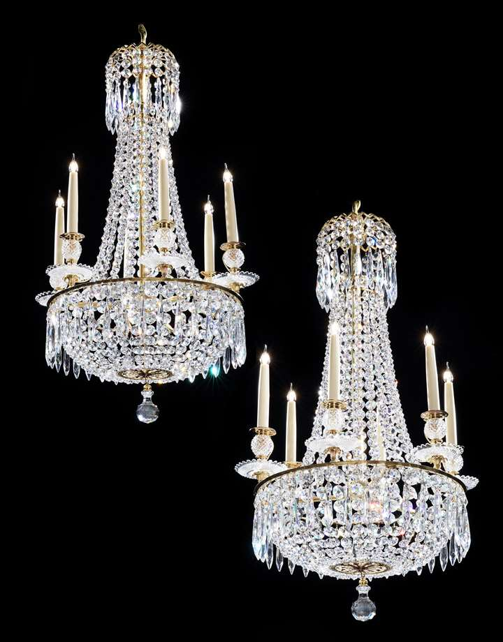 A small pair of regency cut glass six light chandeliers