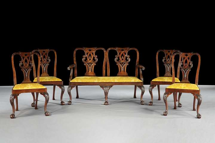 A SUITE OF GEORGE II MAHOGANY SIDE CHAIRS WITH SETTEE