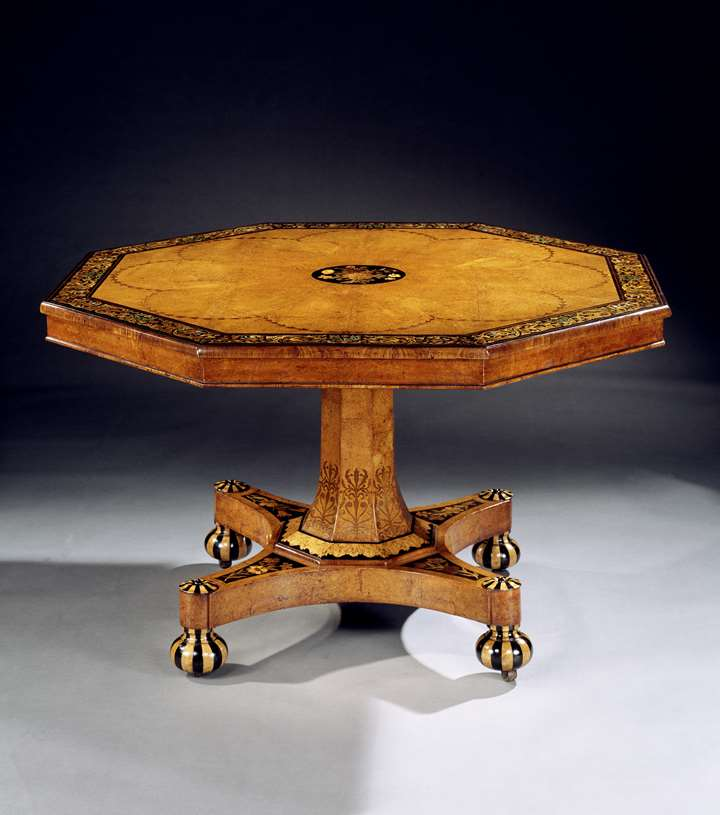 A VICTORIAN INLAID AMBOYNA CENTRE TABLE