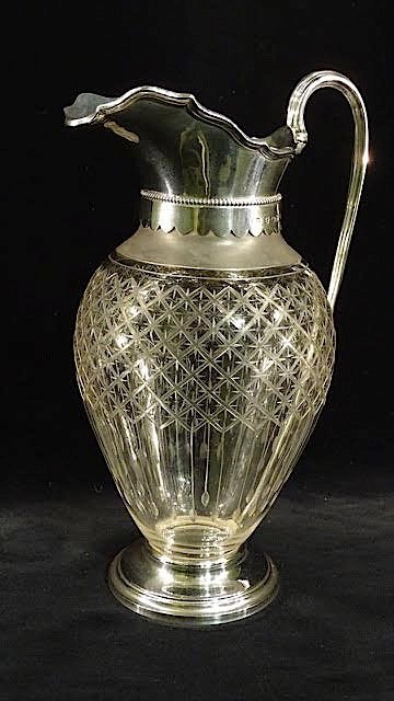 A VICTORIAN SILVER MOUNTED CLARET JUG