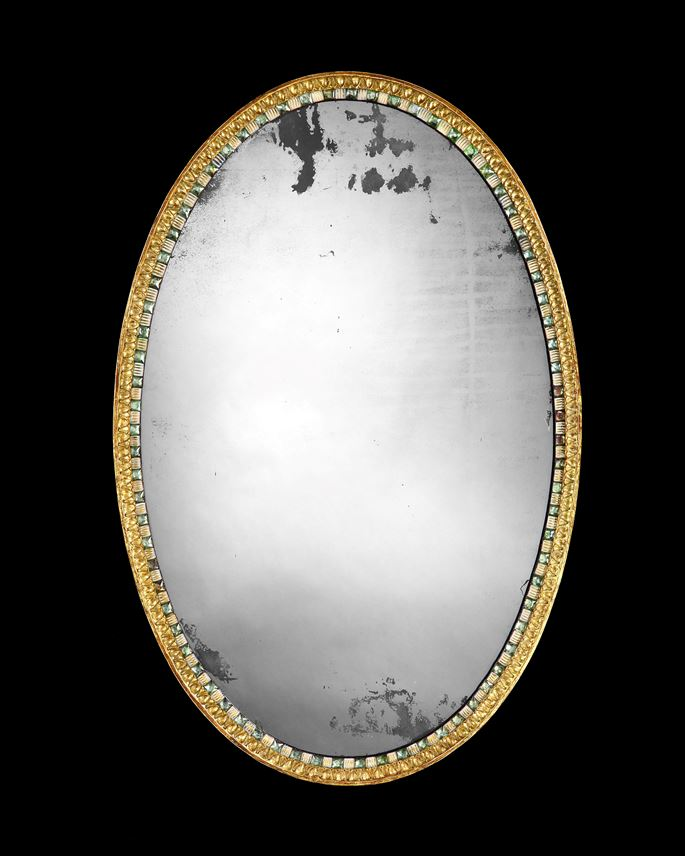 AN IRISH GEORGE III GILTWOOD AND CUT GLASS OVAL MIRROR | MasterArt