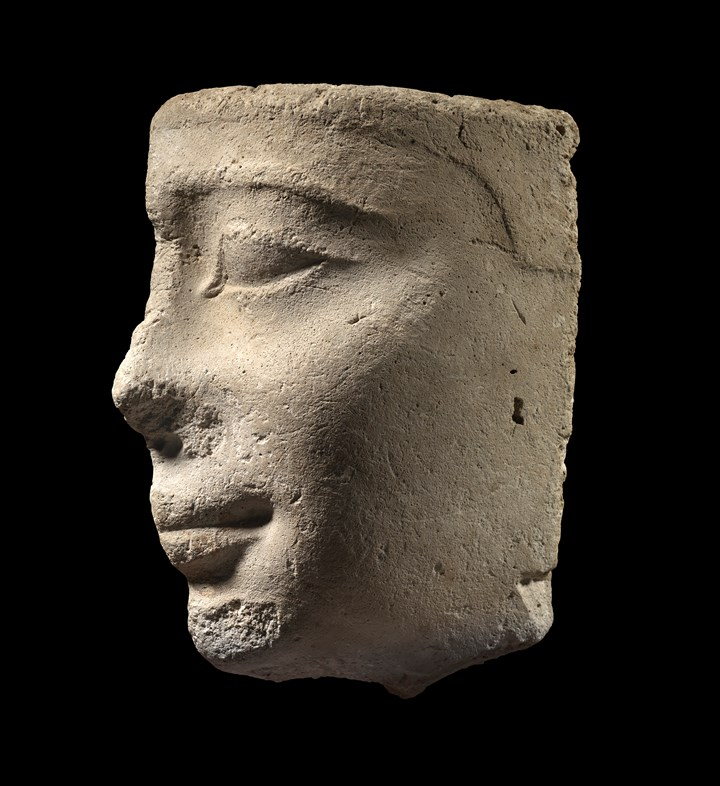 Egyptian stucco profile head of a young man