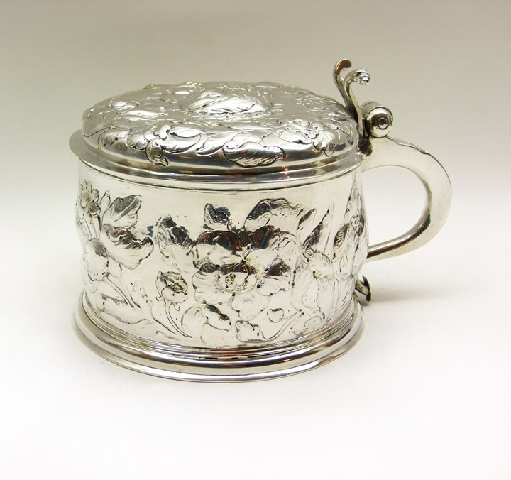 17th century German embossed silver tankard