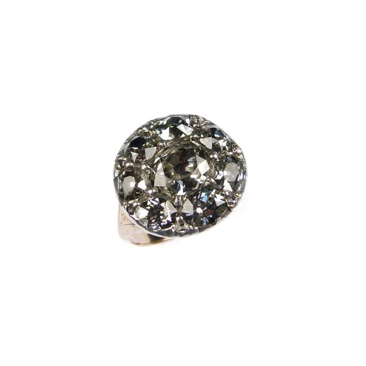 Diamond cluster ring of rounded outline,