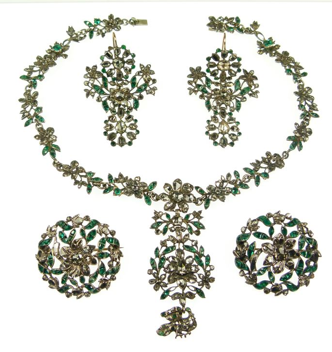 Emerald and diamond floral and foliate cluster suite, comprising a necklace, two brooches and a pair of earrings | MasterArt