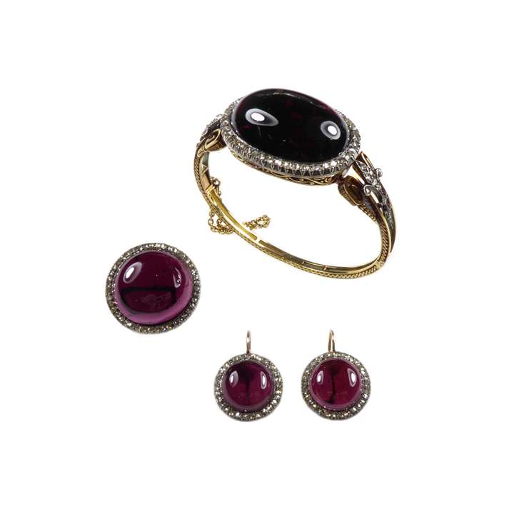 Cabochon pyrope garnet and rose cut diamond cluster set comprising bangle, brooch and pair of earrings