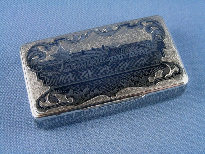 19th century Russian rectangular silver gilt niello box, depicting a row of houses, assaymaster Andrey Kovalskiy