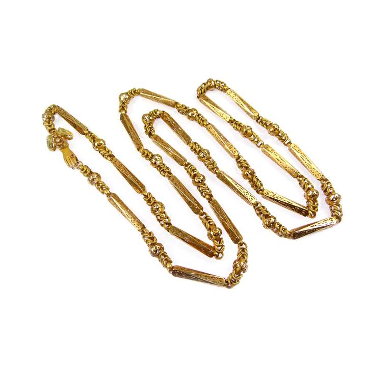 Gold pierced baton and interlinked chain necklace with a hand clasp