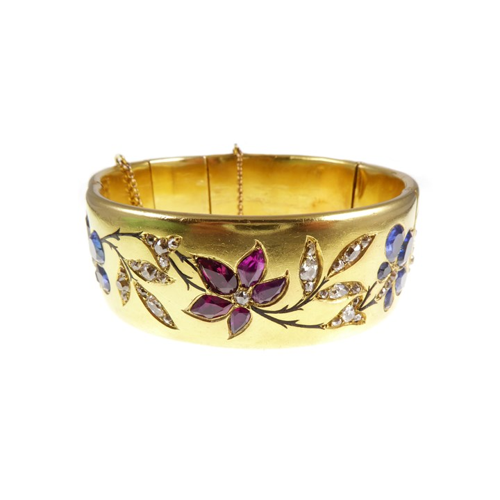 19th century gold, ruby, sapphire and diamond hinged bangle, French c.1880, with presentation inscription to the artist Marie-Louise Roosevelt Pierrepont, Countess Manvers (1889-1984),