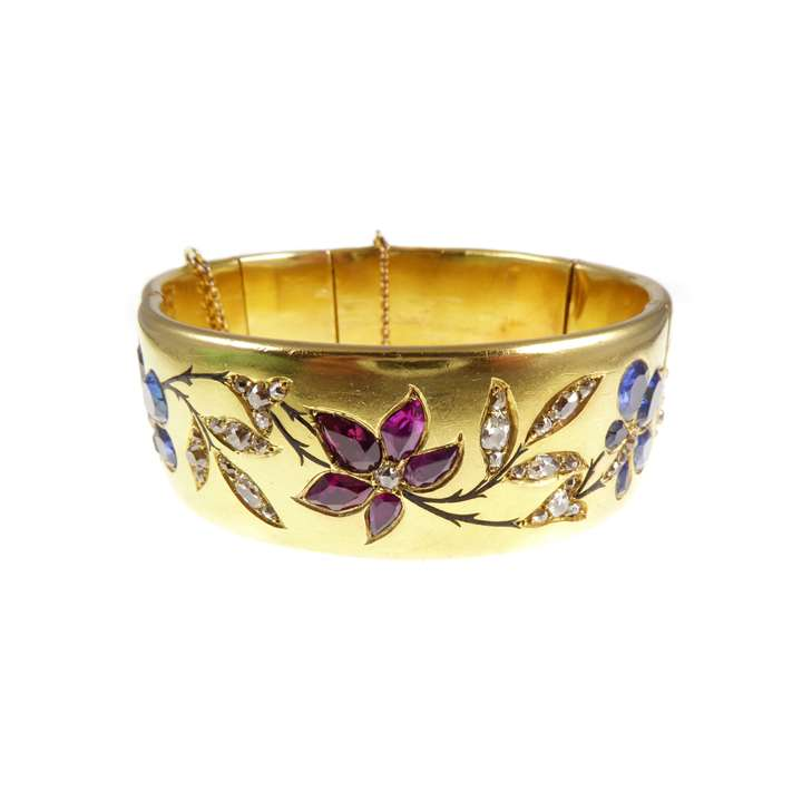 19th century gold, ruby, sapphire and diamond hinged bangle, with presentation inscription to the artist Marie-Louise Roosevelt Pierrepont, Countess Manvers (1889-1984)