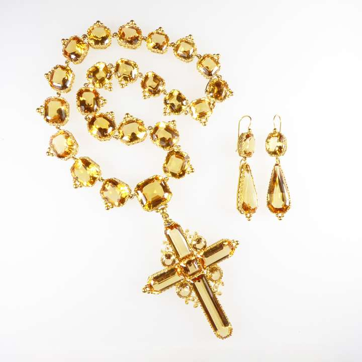 Golden topaz necklace with cross pendant-brooch and pair of pendant earrings en suite