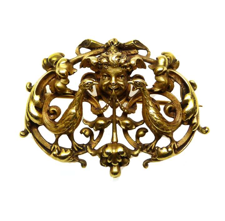 19th century openwork gold maskhead and scroll cartouche brooch by Wiese.