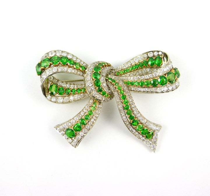 20th century demantoid garnet and diamond bow brooch of 19th century style