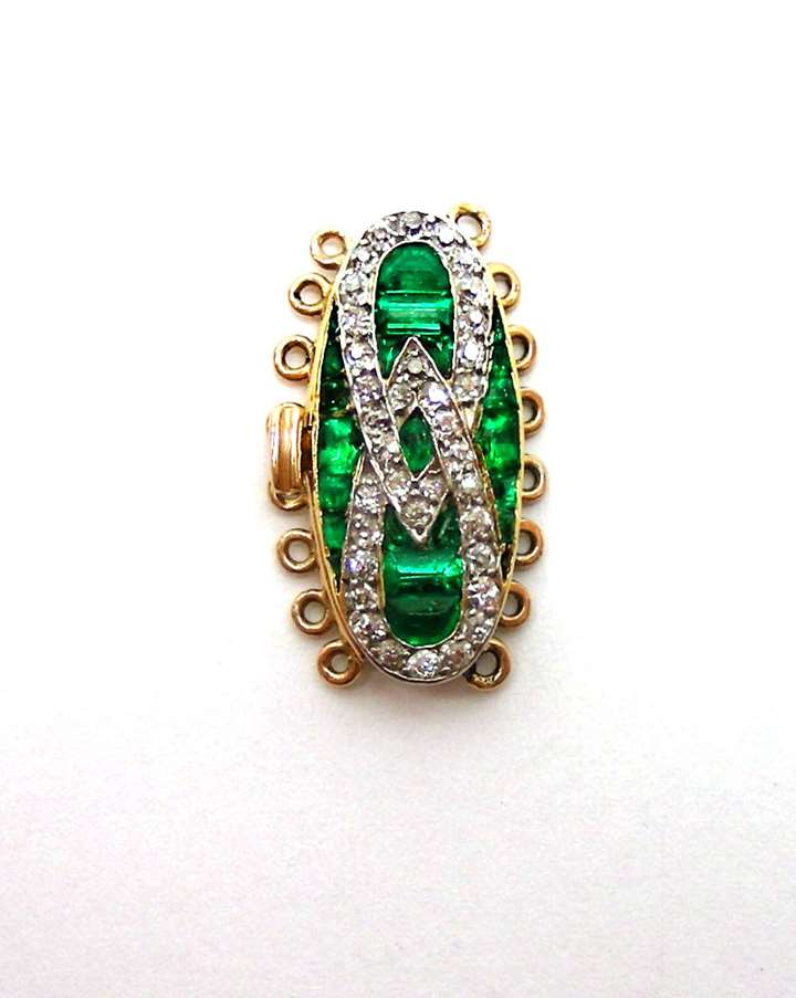An emerald and diamond clasp
