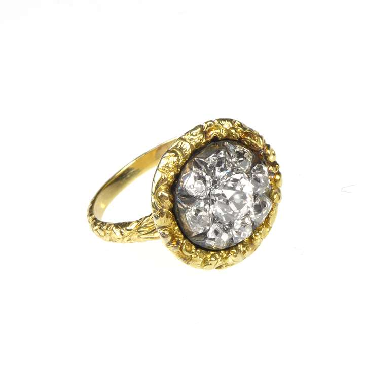 Antique cushion cut diamond circular flowerhead cluster, later mounted as a ring