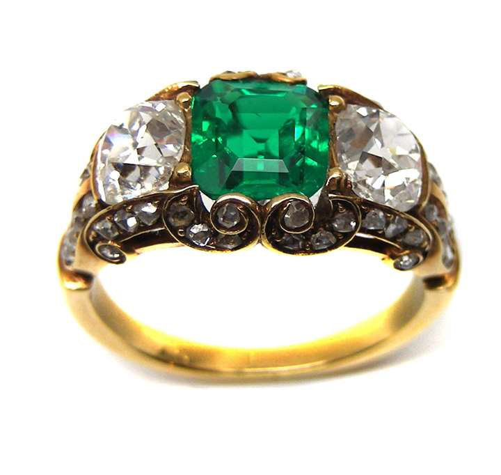 Antique emerald and diamond three stone half hoop ring