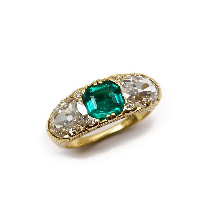 Antique emerald and diamond three stone ring