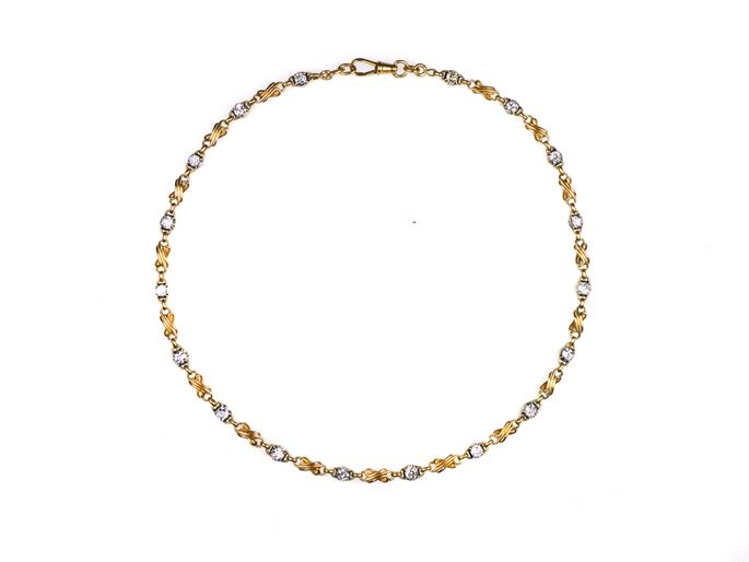 Antique gold and diamond chain necklace, 18 cushion cut diamond collets with stylised figure-of-eight gold scroll sections between | MasterArt