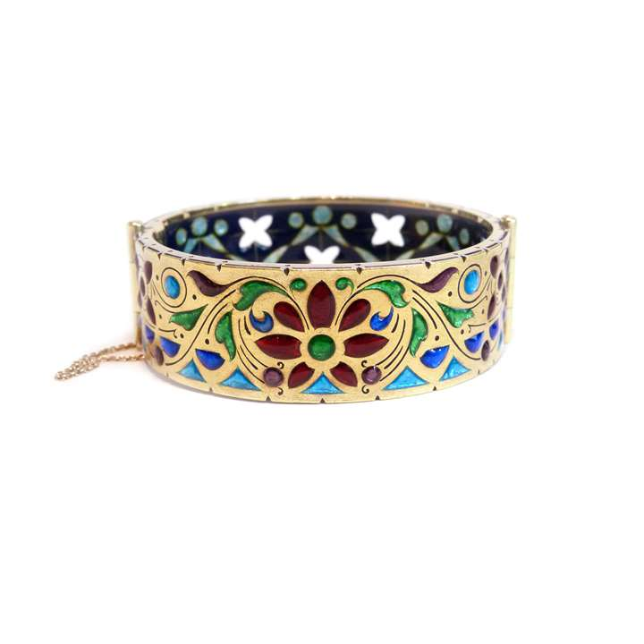 Antique gold and enamel bangle with pierced detail