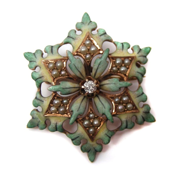 Antique gold diamond, pearl and enamel brooch formed as a snowflake